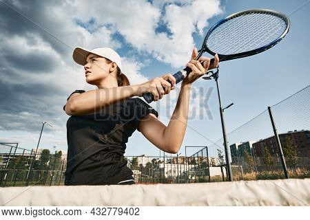 Beautiful Tennis Player Hitting A Backhand Or Volley Shot Tennis Ball Near Net In Motion Outdoors