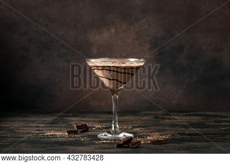 Chocolate Truffle Martini Cocktail On Dark Wooden Background, Copy Space. Mudslide Truffletini Cockt