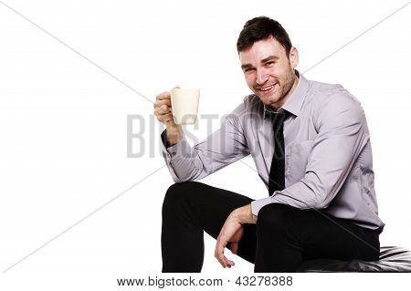 Business Man Sat Holding A Mug