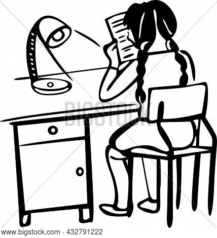 The Girl Is Doing Homework. He Is Sitting At The Desk With A Lamp And Reading