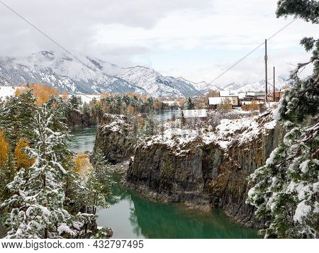 The Turquoise Katun River Against The Background Of The Snow-capped Altai Mountains. Chemal Village,