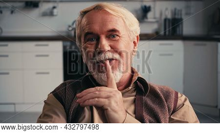 Happy And Bearded Pensioner Smiling While Showing Hush Sign