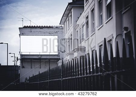 Billboard On Wall At End Of Street