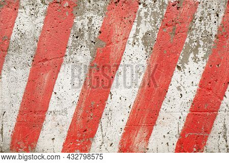 The Texture Of Red And White Stripes Located Diagonally On A Concrete Block Of A City Fence During R