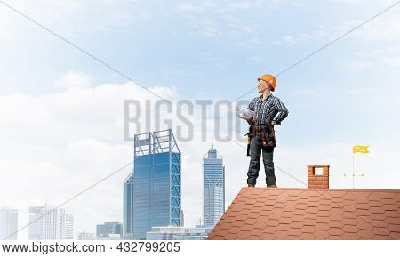 Engineer In Hardhat With Technical Blueprints. Young Female Architect In Shirt And Jeans Standing On