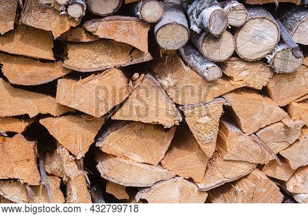 Harvesting For The Winter A Mixture Of Firewood From Different Species Of Trees, Neatly Stacked. Fir