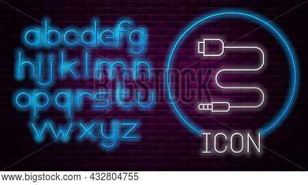 Glowing Neon Line Audio Jack Icon Isolated On Brick Wall Background. Audio Cable For Connection Soun