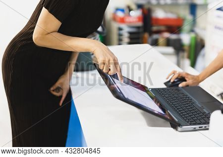 Business Woman Hand Pointing On Laptop Screen To Talking With Teammate Discuss New Project.