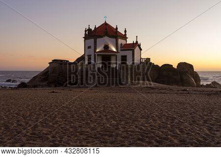 Capela Do Senhor Da Pedra Or Lord Of The Rock Chapel Illuminated At Night, Miramar, Portugal