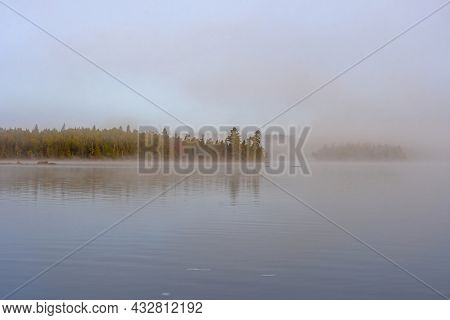 Morning Mist Slowly Clearing In The North Woods On Saganaga Lake In The Boundary Waters In Minnesota