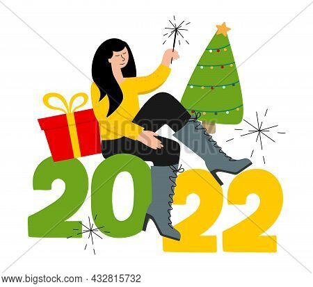 A Girl Is Sitting With A Sparkler. The Concept Of Christmas And New Year. 2022, A Postcard And A Pos