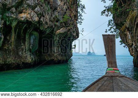 View Of Longtail Boat Passing Through Hong Island In Krabi Thailand Beautiful Island In Krabi Provin