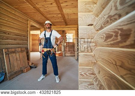 Satisfied Construction Worker With Tool Belt Looking Ahead