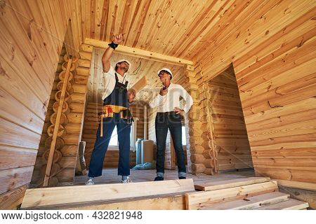 Worker Showing Part Of House To Civil Engineer