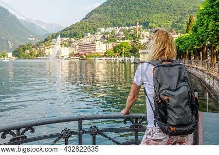 Girl Looking The Water Jet Of Paradiso Fountain Of Lugano City In Lugano Lake Of Switzerland. Waterf
