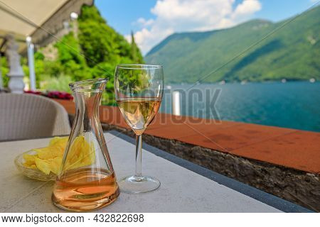 Rose Wine Flute By The Lakefront Of Lugano City In Switzerland. Romantic Appetizer In Ticino Canton