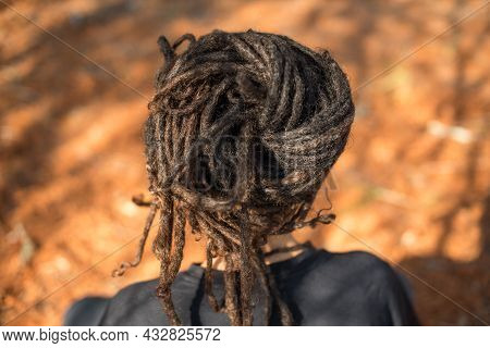 Rear View Of Person With Locs Wrapped Shot From Behind