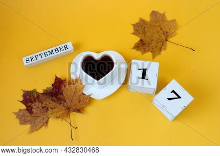 Calendar For September 17 : The Name Of The Month In English, Cubes With The Number 17,a White Heart