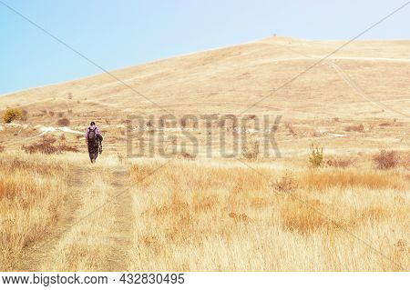 Lonely Male Photographer Is Walking On The Steppe On The Horizon, Vacation, Travel