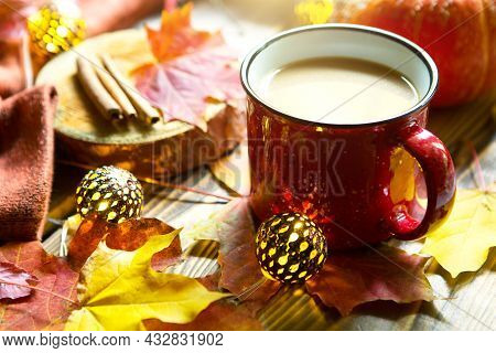 Red Mug With Hot Cocoa On Table With Fallen Maple Leaves, Round Lamps, Garlands, Cinnamon Sticks, Wa