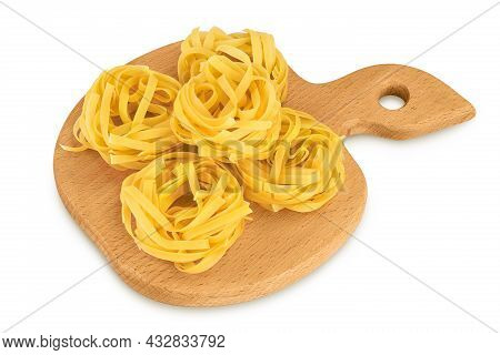 Raw Tagliatelle Pasta On Wooden Board Isolated On White Background With Clipping Path And Full Depth