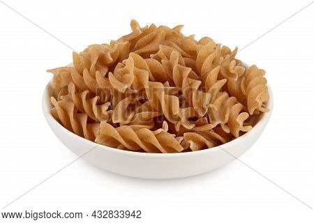 Wolegrain Fusilli Pasta From Durum Wheat In Bowl Isolated On White Background With Clipping Path And