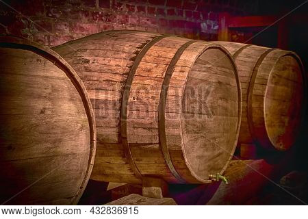 Old Barrels Of Wine In A Dark Basement