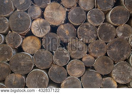 The Background Is Made Of Firewood.firewood Stacked In A Pile.
