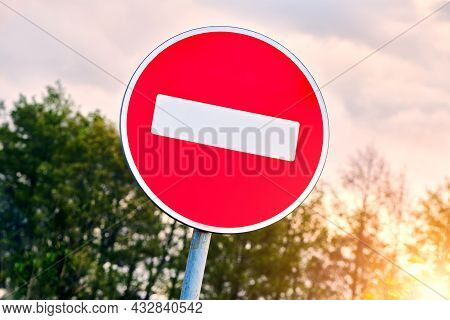 No Entry Road Sign Agains The Sky. The Road Is Closed Red Round Sign. White Brick In Red Circle Road