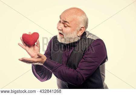 Health Care. Senior Bald Head Bearded Man Hold Red Heart. Preventing Heart Attack. Heart Problem And