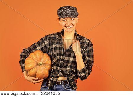 Harvest In Garden. Homegrown Pumpkin. Organic Farming. Family Farm. Woman Rustic Farmer Presenting P
