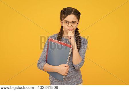 Homework Develops Study Habits. Serious Girl Hold Books. Thinking On Homework. Homework Assignment.