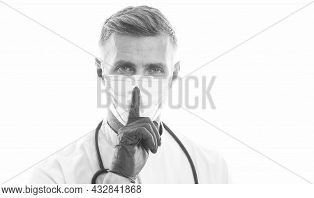 Medical Worker Man Physician In Respirator Mask And Rubber Gloves With Phonendoscope Show Hush Gestu