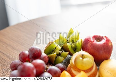 Composition With Fresh Mixed Fruits On Plate.assortment Of Juicy Fruits On Wooden Table.fruit Platte
