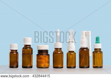 Group Of Mockup Medical Pills Containers And Nasal Throat Sprays