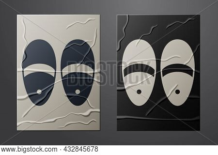 White Slippers Icon Isolated On Crumpled Paper Background. Flip Flops Sign. Paper Art Style. Vector
