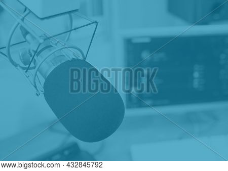 Composition of broadcasting microphone in radio studio on blue background. radio communication concept, template with copy space digitally generated image.
