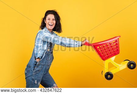 Quality Service. Female Shopper With Trolley In Supermarket. Woman Shopping In Supermarket Pushing T