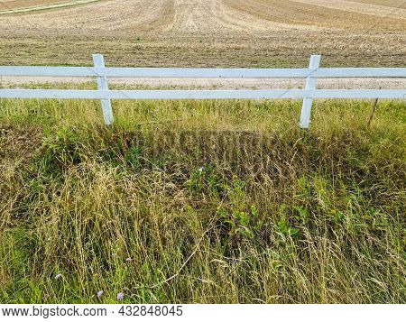 Beautiful Wooden Horse Fence At An Agricultural Field On A Summer Day.