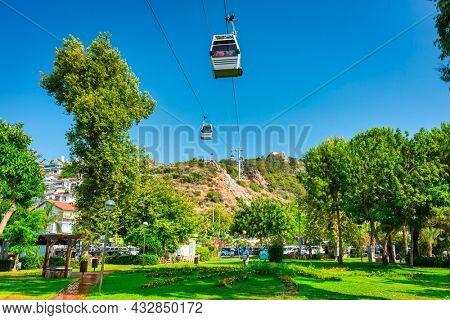 Alanya, Turkey - July 21, 2021: Teleferik ropeway in Alanya city to the 13th century Alanya Castle on the hill by the Mediterranean Sea, Turkey.