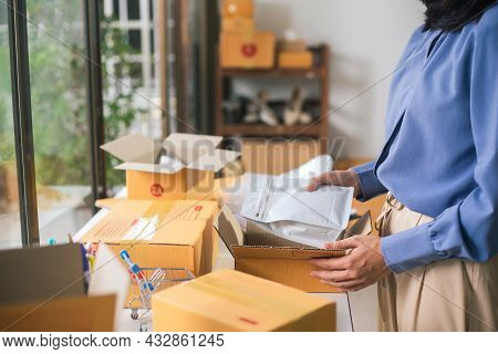 Female Worker Or Seller Packing Roasted Coffee Beans In Packaging Ecommerce Shipping Order Box For D