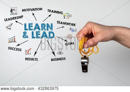 Learn And Lead, Business Concept. Metal Whistle In A Womans Hand