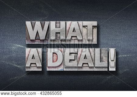 What A Deal Phrase Made From Metallic Letterpress On Dark Jeans Background