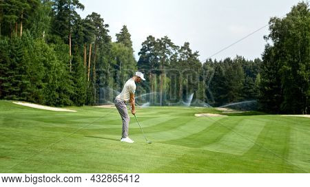 Young golfer in uniform playing golf outdoors