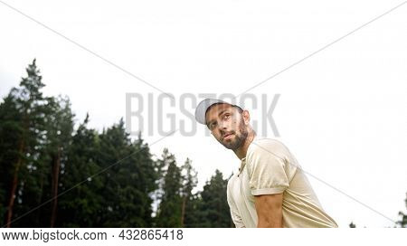Young man playing golf on the field