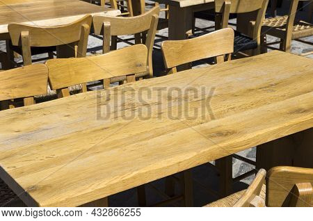 Wooden Table And Chairs Outside In A Tavern