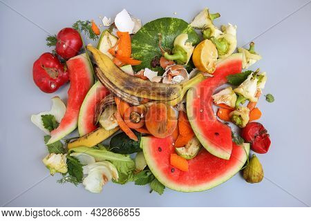 Household Waste For Composting From Fruits And Vegetables On A Gray Background. Top View. Flat Lay.