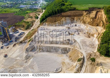 Open Pit Mining Of Construction Sand Stone Materials With Excavators And Dump Trucks.