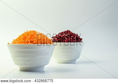 Grated Carrot And Grated Beetroot In The White Bowl. Selective Focus. Side View.