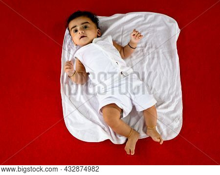 Cute Indian Boy Child In White Color Baptismal Dress